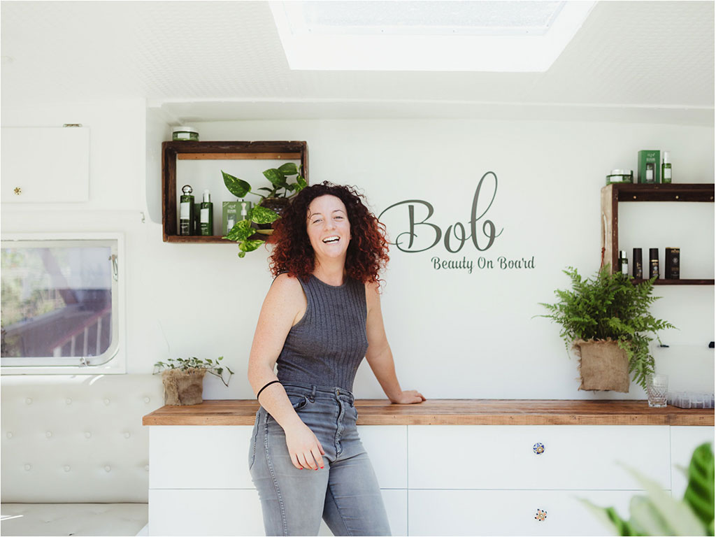 Emily K standing casually in BOB the Mobile Hair and Beauty Caravan